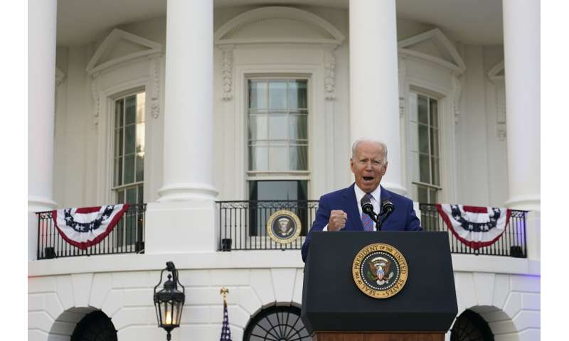 Biden: US 'coming back together,' but COVID not yet finished