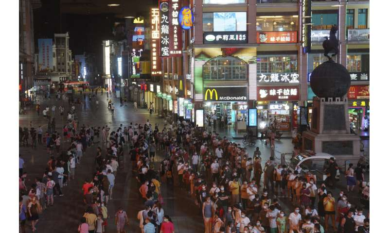 Chinese city locks down neighborhood after virus upsurge