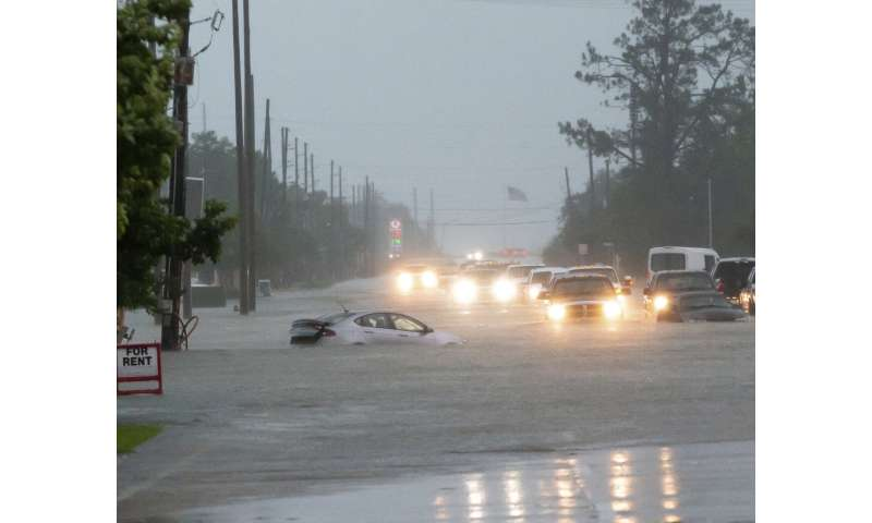 Drenching rains flood homes, swamp cars in south Louisiana