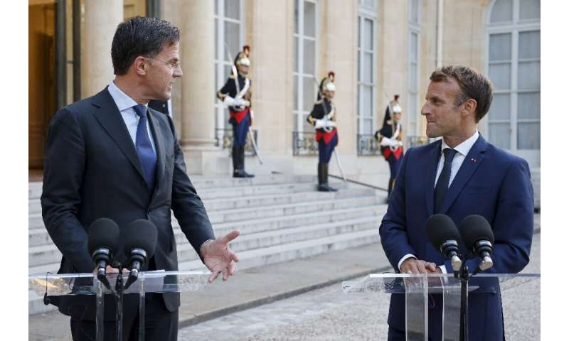 Dutch Prime Minister Mark Rutte often towers over his counterparts, including French President Emmanuel Macron