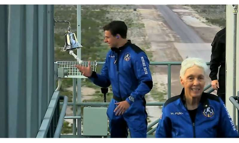 Dutch teen Oliver Daemen (L) and Wally Funk prepare to board the Blue Origin craft—they are now the youngest and oldest astronau