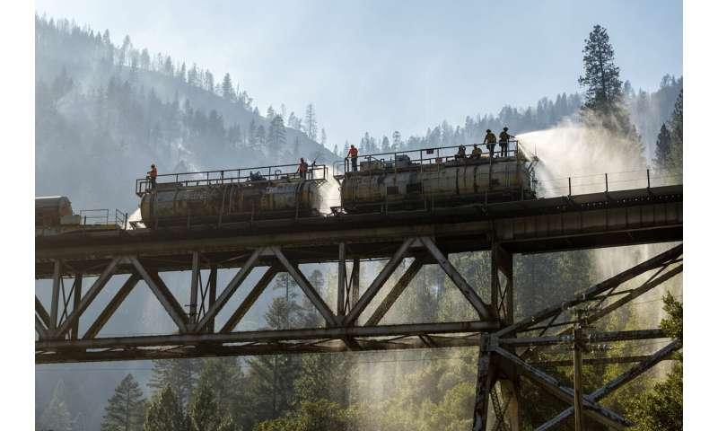 Erratic Oregon wildfire destroys dozens of homes, expands