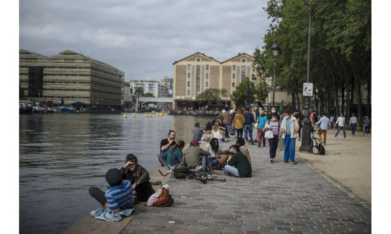 France tackles virus variants as it readies for tourists
