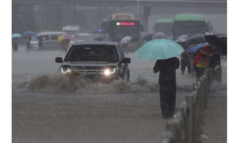 Heavy flooding hits central China; subways inundated