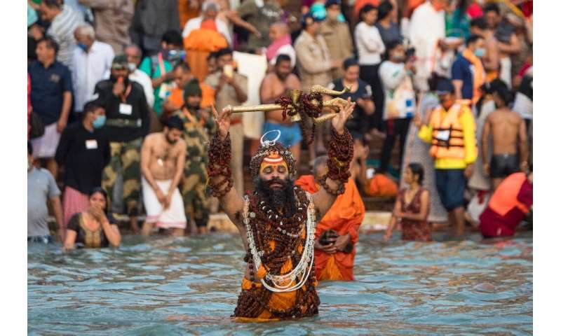 Hundreds of thousands of mostly maskless Hindu devotees have descended on the River Ganges for the event