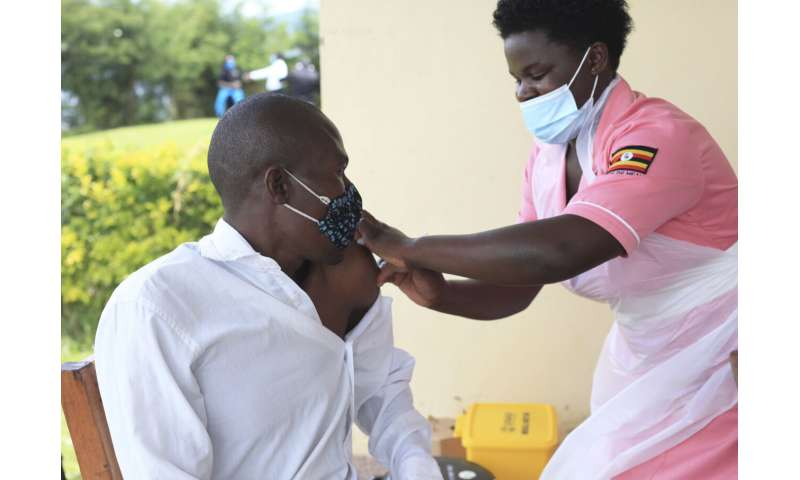 In Uganda, remote islands test delivery of COVID-19 vaccines