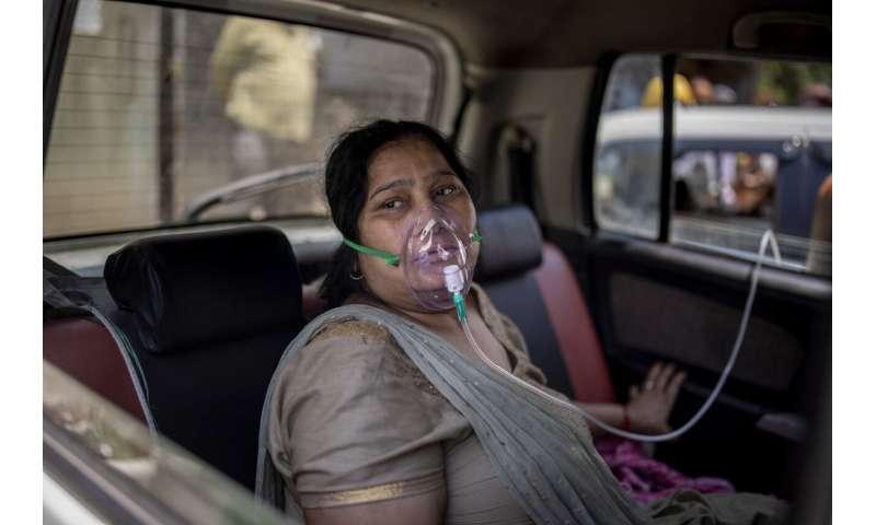 India tops 200,000 dead as virus surge breaks health system
