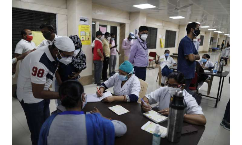 India's surge hits southern states, prompts more lockdowns