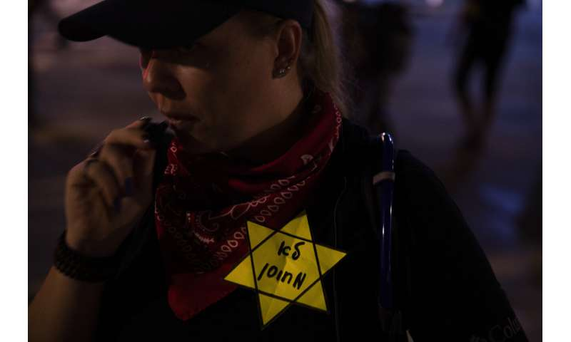 Israel tightens COVID 'green pass' rules, sparking protest