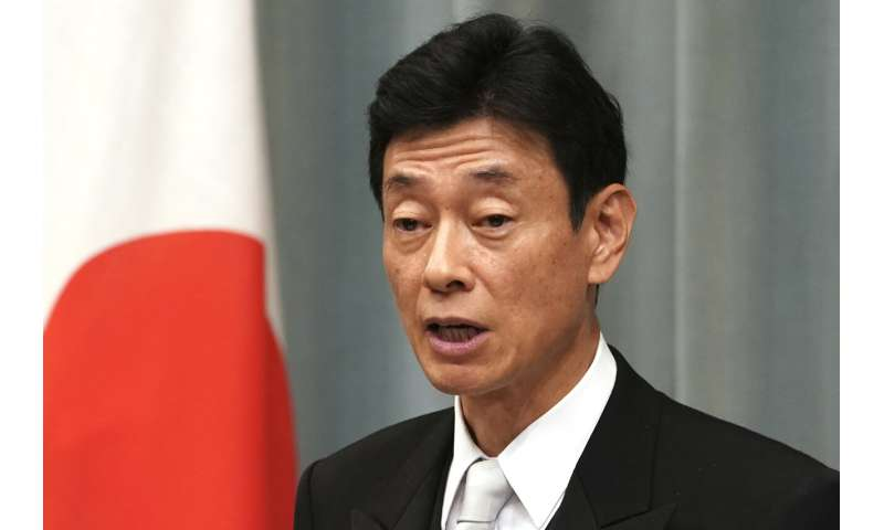 Japan passes 50% vaccination rate, may ease limits in Nov.