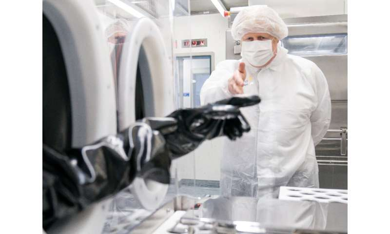 Johnson, shown here at an AstraZeneca manufacturing plant in northwest England, promised to toast the latest easing with a celeb