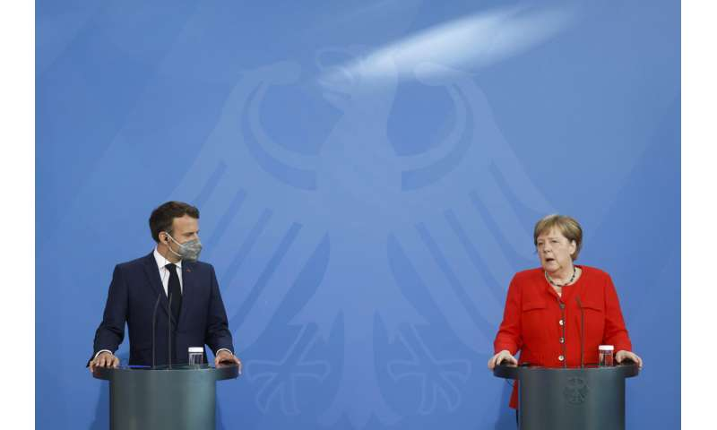 Leaders of Germany, France urge vigilance over virus variant