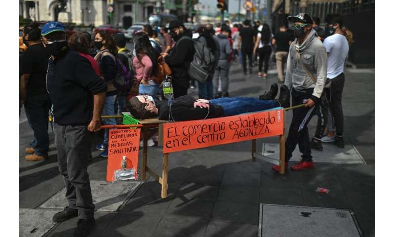 Lockdown protesters carry a mannequin symbolising ailing businesses in  Mexico City.