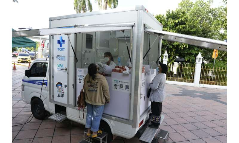 Lockdowns in Asia as some nations see 1st major virus surges