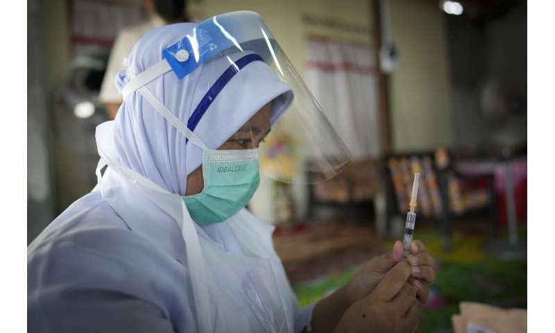 Malaysia shuts vaccination center after 204 staff infected