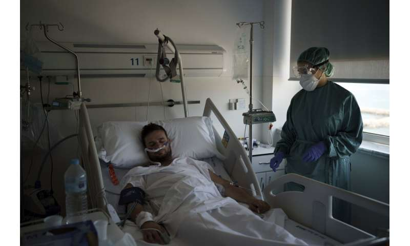 New virus surge sends younger patients to Spain's hospitals