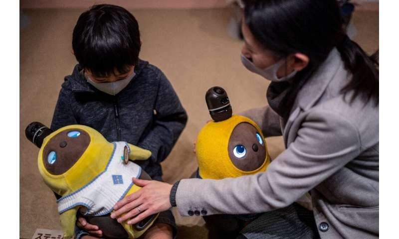 People can visit the Lovot Cafe near Tokyo to interact with the bots, which have big round eyes and penguin-like wings that flut