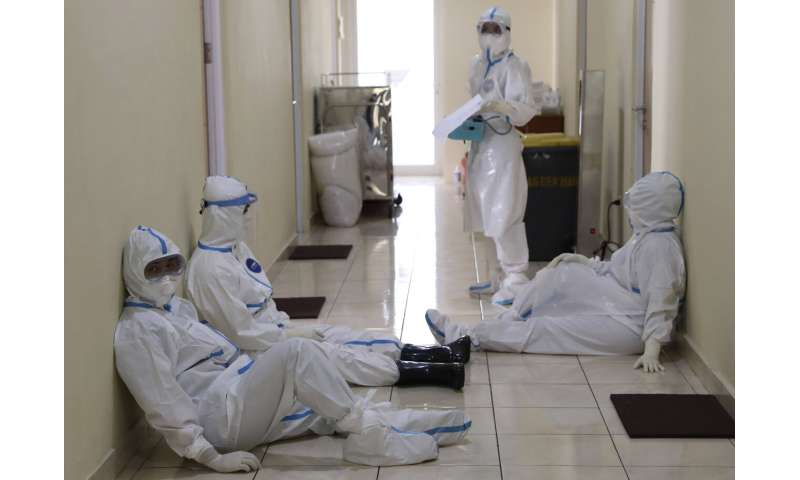 Rapid virus spread through Indonesia taxes health workers