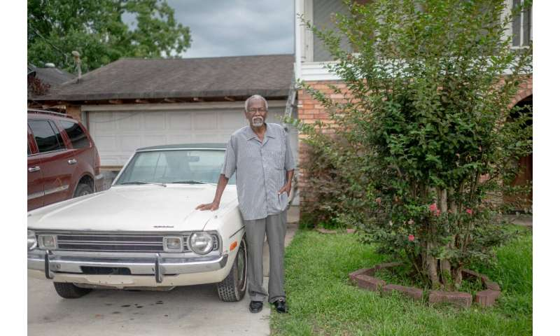 Robert Taylor, seen in front of his home in Reserve, Louisiana, has seen his mother, sister, wife and nephews all suffer from ca