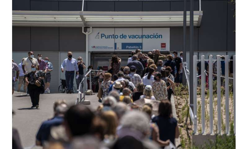 Spaniards put faith in COVID-19 vaccines even as cases surge