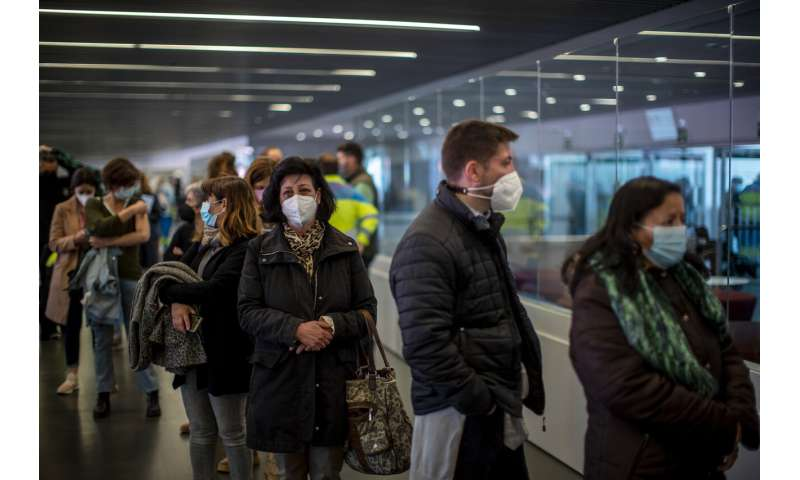 Spaniards line up for AstraZeneca amid concerns over vaccine