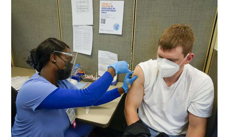 States race to use COVID-19 vaccines before they expire