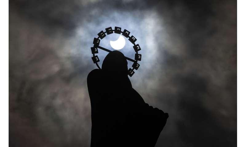 Sunrise special: Solar eclipse thrills world's northern tier