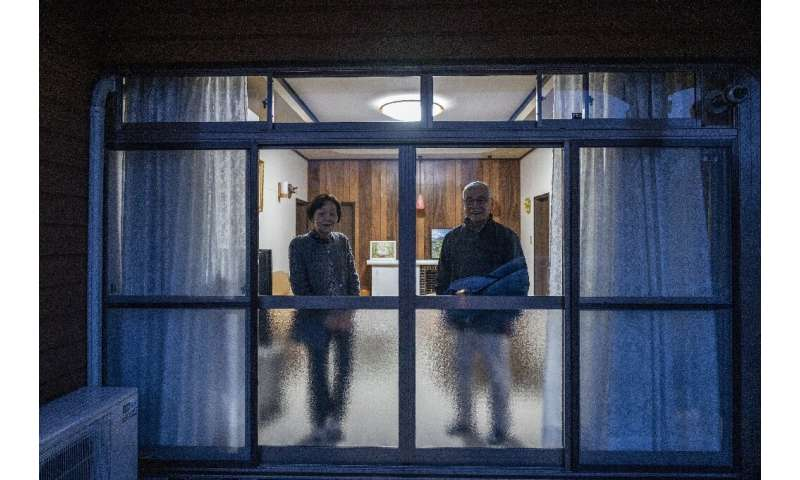 Takao Kohata (R) went back to Minamisoma after authorities lifted restrictions but is still haunted by radiation fears