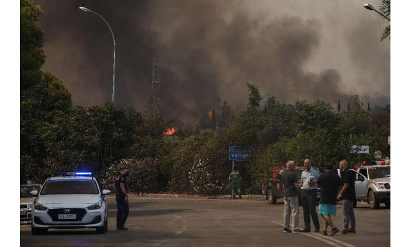The fire brigade said five helicopters, five water-bombing aircraft, 70 fire trucks and 350 firemen were fighting the flames