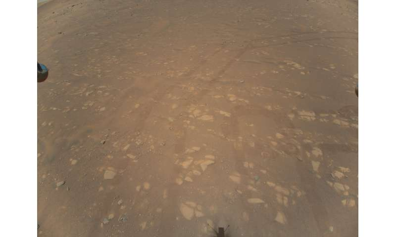 This NASA photo obtained April 25, 2021 shows the first color image of the Martian surface taken by an aerial vehicle while it w