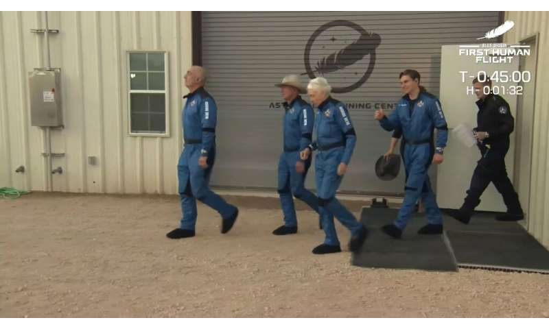 This still image taken from video by Blue Origin shows (L-R) Mark Bezos, Jeff Bezos,  Wally Funk and Oliver Daemen as they trave