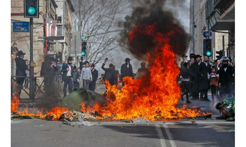Ultra-Orthodox Jewish protesters clash with Israeli security forces during the enforcement of the coronavirus emergency regulati