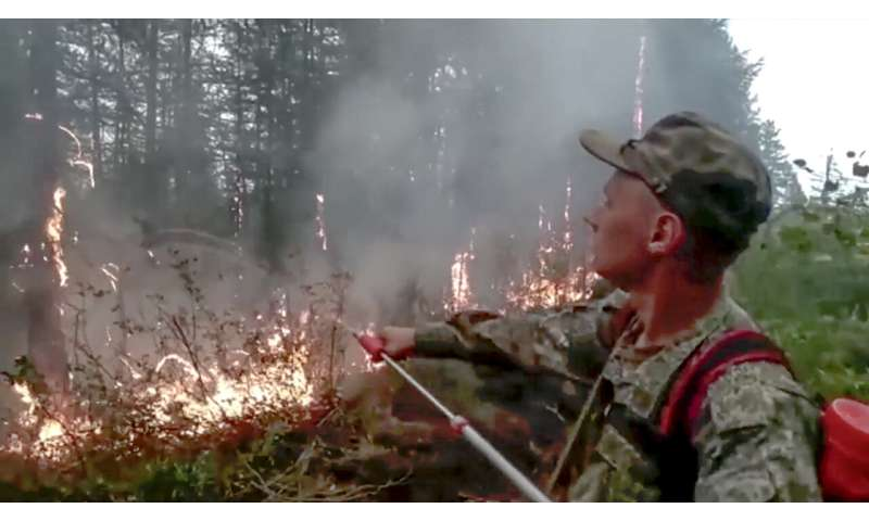 Wildfires endanger villages, fuel site, in Russia's Siberia
