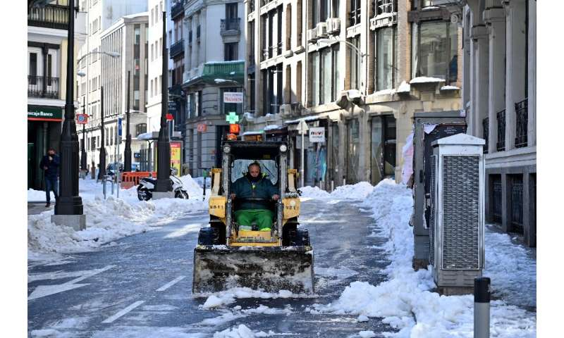 Work continued Monday to clear roads