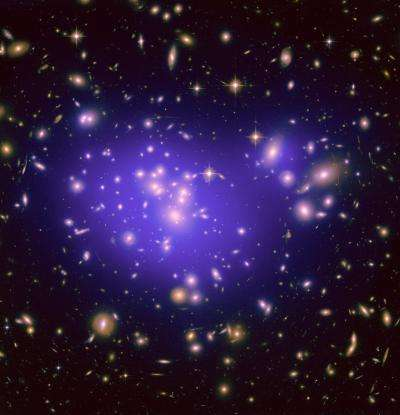Astronomers use galactic magnifying lens to probe elusive dark energy