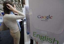 A visitor checks out the Google stand at the Frankfurt Book Fair