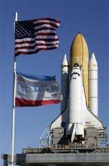 Space shuttle moved to launch pad on freezing morn (AP)
