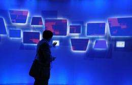Attendees try an interactive display at the Microsoft booth at the 2010 International Consumer Electronics Show