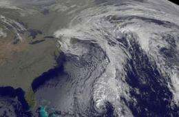 GOES-13 satellite sees cold front stalking remnant low of Tomas
