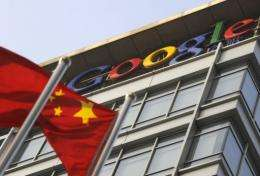 A Chinese flag flies over the company logo outside the Google China headquarters in Beijing