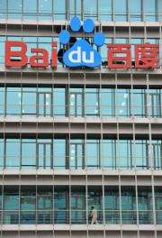 A Chinese worker cleans the balcony of Chinese Web search giant Baidu's headquarters in Beijing