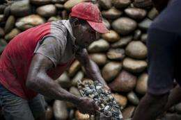 A green gold miner works with his relatives at their shared mine in the community of Angostura in Tado