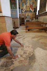 A Jordanian man cleans the Madaba Map