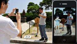 A man stands (L) has his photo taken with the doe-eyed cartoon character, Rinko