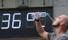 A man takes a gulp of water