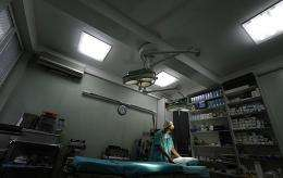 A medical worker cleans a surgery room