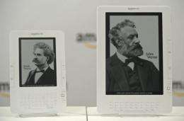 An Amazon.com Kindle DX (right), a larger-screen version of its popular Kindle reader