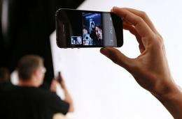 """An Apple employee demonstrates """"Face Time"""" on the new iPhone 4"""