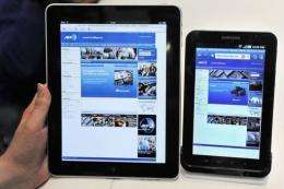 "An Apple iPad displayed next to Samsung's new tablet device, the ""Galaxy Tab"""