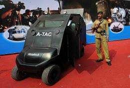 An Indian paramilitary soldier stands guard by an Anti-Terrorist Assault Cart (ATAC)